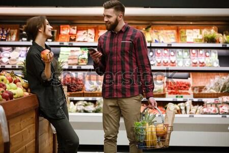 Paar kopen kruidenier winkel gelukkig Stockfoto © deandrobot