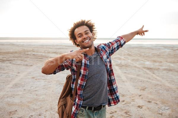 Feliz africano moço indicação longe tanto Foto stock © deandrobot