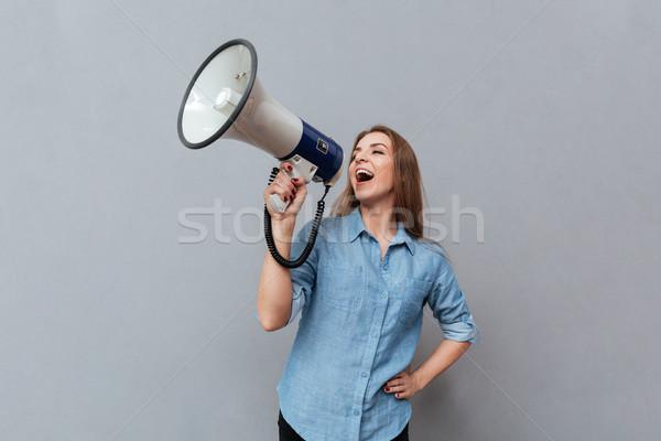 Woman screaming in megaphone Stock photo © deandrobot