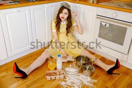 довольно молодые pinup Lady сидят полу Сток-фото © deandrobot