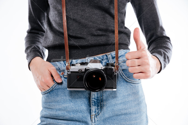Woman in denim jeans with retro camera showing thumbs up Stock photo © deandrobot