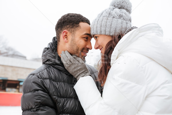 Happy couple in love hugging outdoors in winter Stock photo © deandrobot