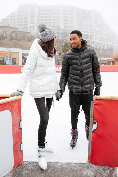 Couple skating together and holding hands at outdoor rink Stock photo © deandrobot