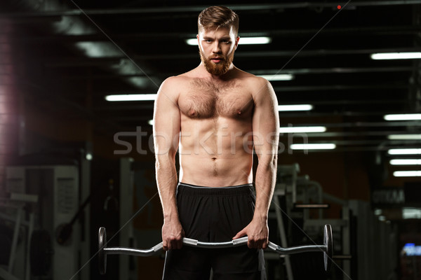 Concentrated sports man make sport exercises Stock photo © deandrobot