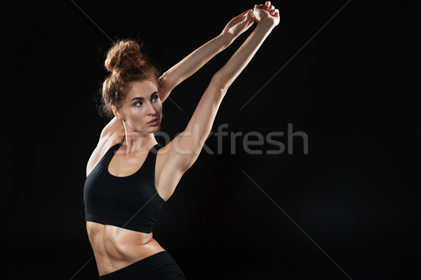 Young Fitness woman doing yoga exercises Stock photo © deandrobot