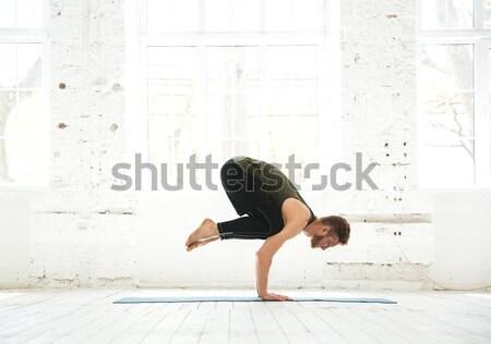 Człowiek zaawansowany jogi widok z boku młody człowiek Zdjęcia stock © deandrobot