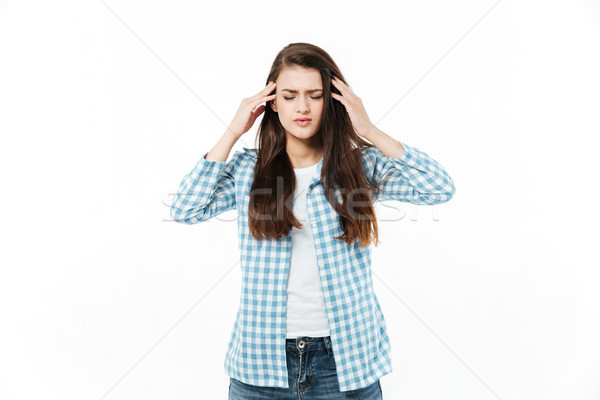 Portrait of a young casual woman suffering from migraine Stock photo © deandrobot
