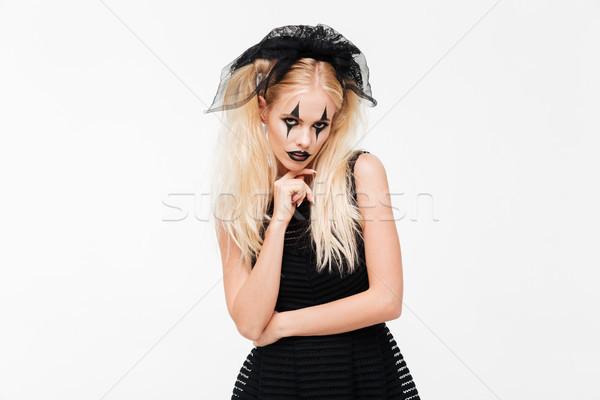 かなり 若い女性 黒 未亡人 衣装 ポーズ ストックフォト © deandrobot
