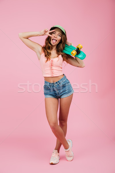 Full length portrait of a young woman in summer clothes Stock photo © deandrobot