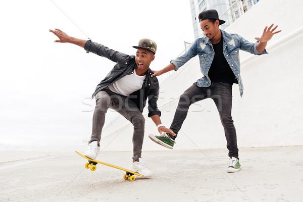 érzelmes kettő fiatal afrikai férfiak barátok Stock fotó © deandrobot