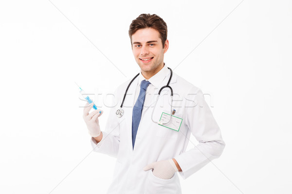 Portrait of a smiling young male doctor with stethoscope Stock photo © deandrobot