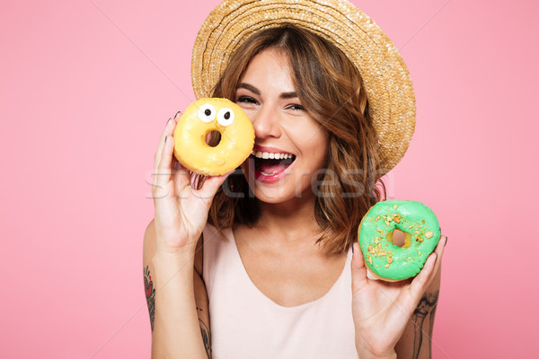 Close up portrait of a funny smiling woman in summer hat Stock photo © deandrobot
