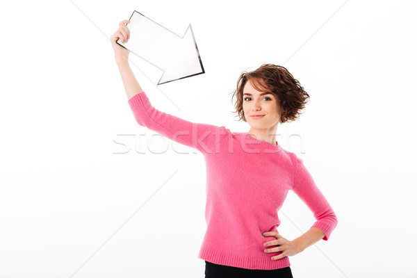Portrait of a satisfied pretty girl pointing at herself Stock photo © deandrobot