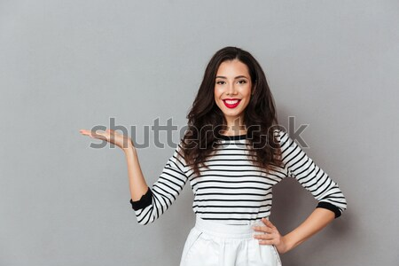Portrait of adorable smiling woman with trendy hair talking on m Stock photo © deandrobot