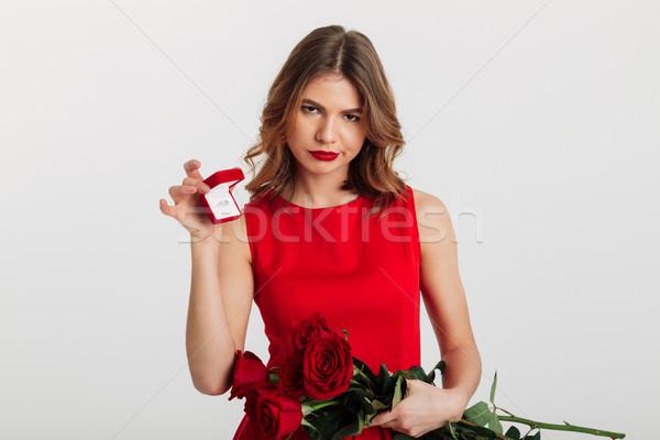 Portret teleurgesteld jonge vrouw rode jurk vak Stockfoto © deandrobot