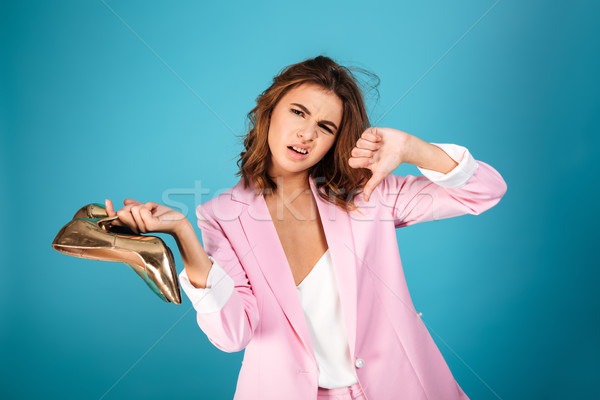 Portrait of an upset woman dressed in pink suit Stock photo © deandrobot