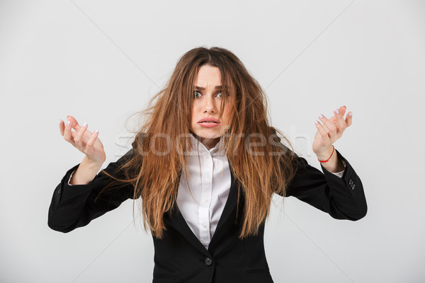 Portrait of a frustrated businesswoman dressed in suit Stock photo © deandrobot