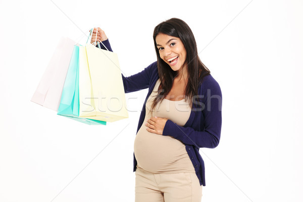 Portait of a satisfied young pregnant woman Stock photo © deandrobot
