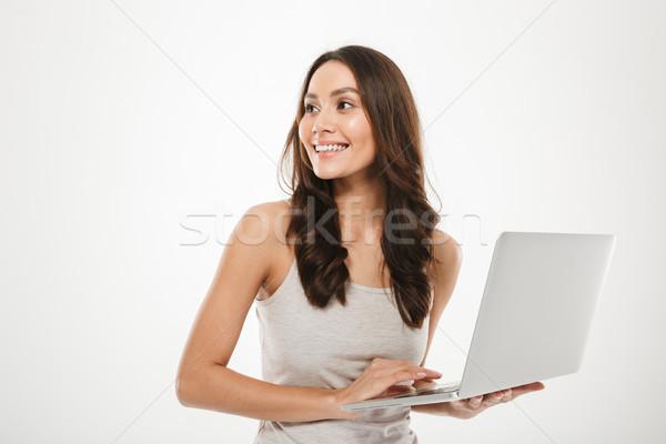 写真 笑顔の女性 長い 茶色の髪 作業 ストックフォト © deandrobot