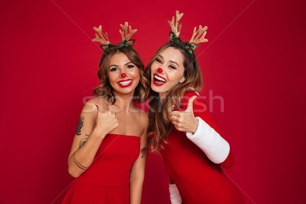 Felice giovani donne amici indossare Natale cervo Foto d'archivio © deandrobot