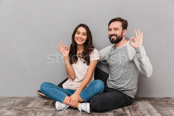 портрет удовлетворенный сидят вместе Сток-фото © deandrobot