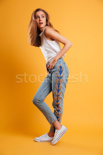 Full length portrait of an attractive young girl Stock photo © deandrobot
