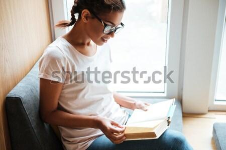若い女性 カップ コーヒー ラップトップを使用して ストックフォト © deandrobot