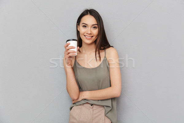 Portrait of a lovely asian woman take away coffee cup Stock photo © deandrobot
