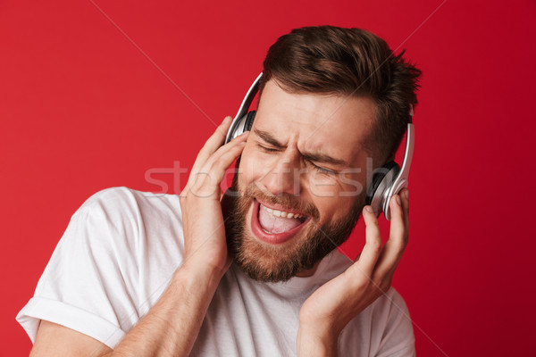 Emotional screaming young man isolated Stock photo © deandrobot