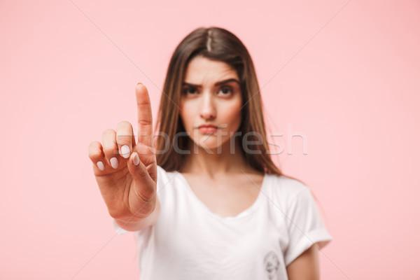 Portrait of a confident young woman Stock photo © deandrobot