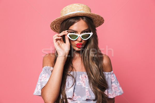 Portrait of a seductive young girl in summer clothes Stock photo © deandrobot