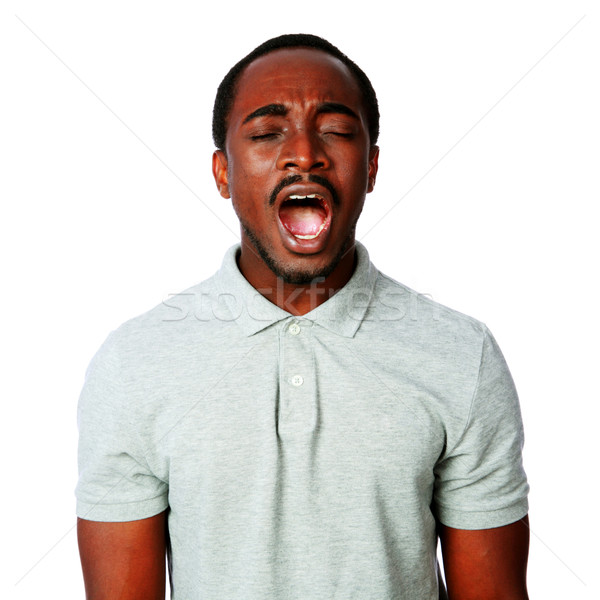 Portrait of african man shouting isolated on white background Stock photo © deandrobot