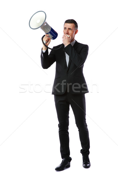 Full length portrait of businessman shout through megaphone isolated on white background Stock photo © deandrobot