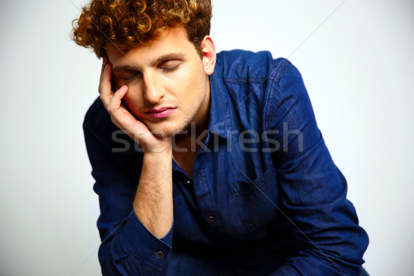 Tired man with closed eyes over gray background Stock photo © deandrobot