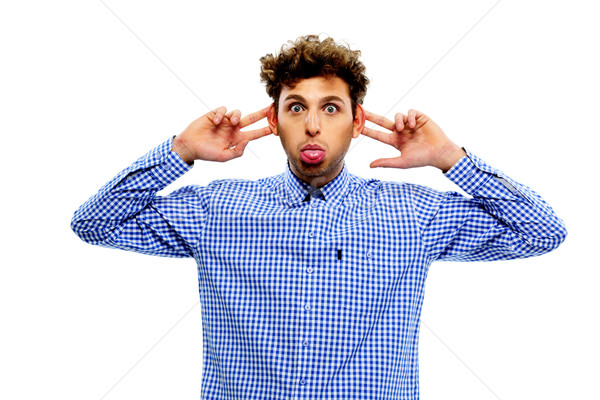 Man sticking out tongue over white background Stock photo © deandrobot