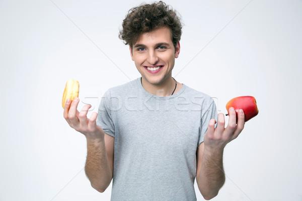 Sonriendo hombre manzana buñuelo gris Foto stock © deandrobot