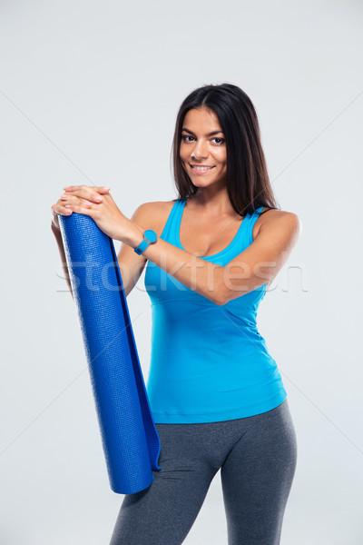 Mutlu spor kadın yoga mat gri Stok fotoğraf © deandrobot
