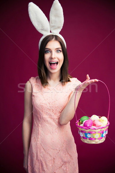 Woman with an Easter egg basket Stock photo © deandrobot
