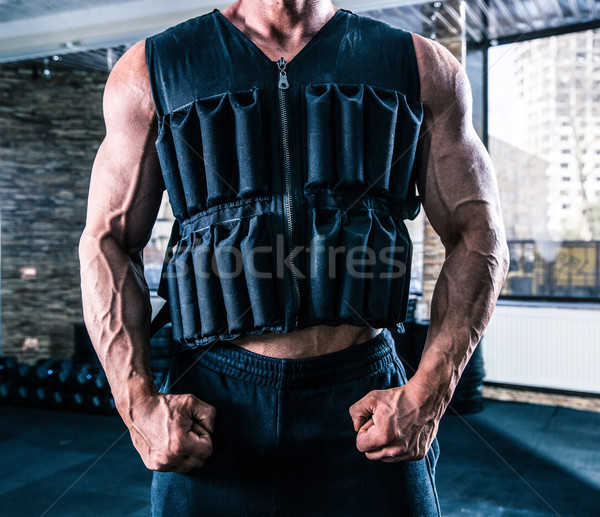 Closeup image of a man wearing in weighting cloth Stock photo © deandrobot
