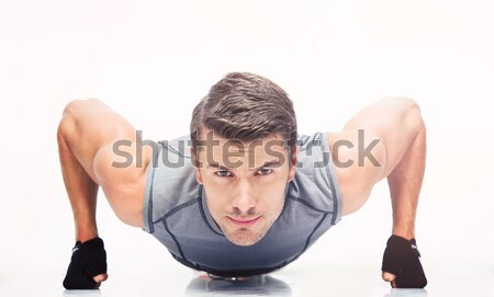 Sports young man doing push ups Stock photo © deandrobot