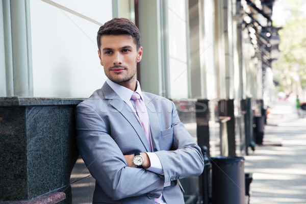Portrait of a handsome businessman with arms folded Stock photo © deandrobot