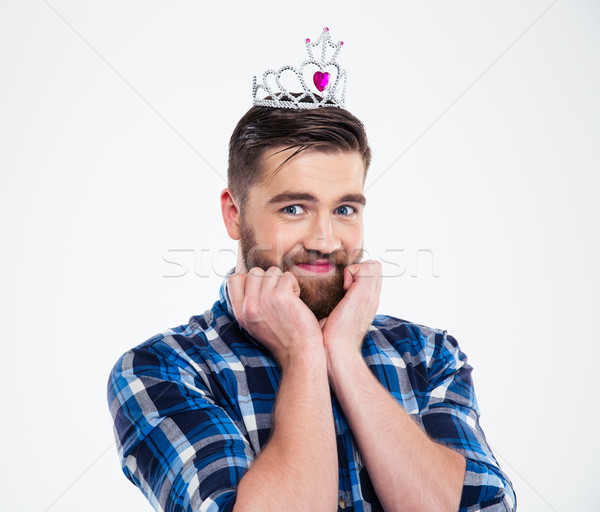 Portrait of a happy feminine man in queen crown Stock photo © deandrobot