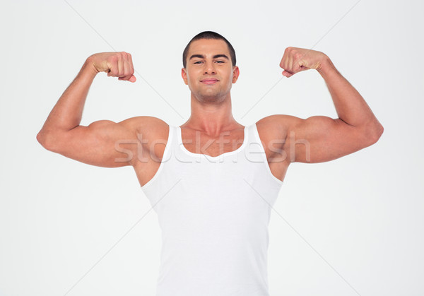 Happy muscular man showing his biceps  Stock photo © deandrobot