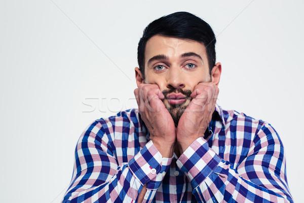 портрет задумчивый человека глядя камеры изолированный Сток-фото © deandrobot