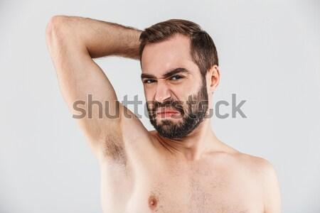 Muscular naked man looking at camera Stock photo © deandrobot