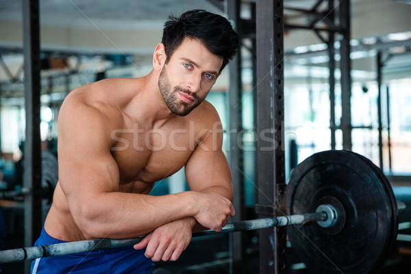 Muscular male bodybuilder looking at camera  Stock photo © deandrobot