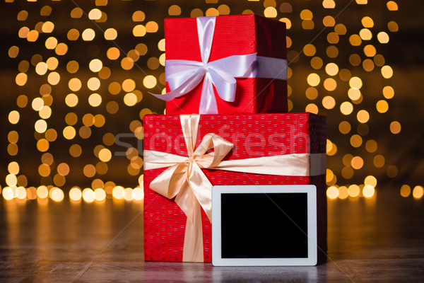 Stock photo: Gift boxes and tablet computer standing on the floor