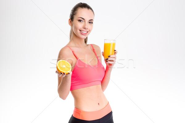 Сток-фото: счастливым · Фитнес-женщины · апельсиновый · сок · улыбаясь