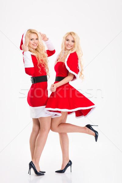 Kettő szőke nő gyönyörű nővérek ikrek mikulás Stock fotó © deandrobot