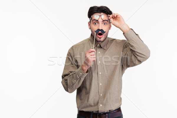 Shocked man holding stick with mustache Stock photo © deandrobot